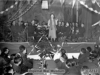 Fields, accompanied by an RAF orchestra, entertains airmen at their 1939 Christmas party Gracie Fields entertains airmen during WW2.jpg