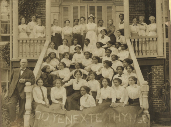 nursing students posing for a photo in front of their dorm.