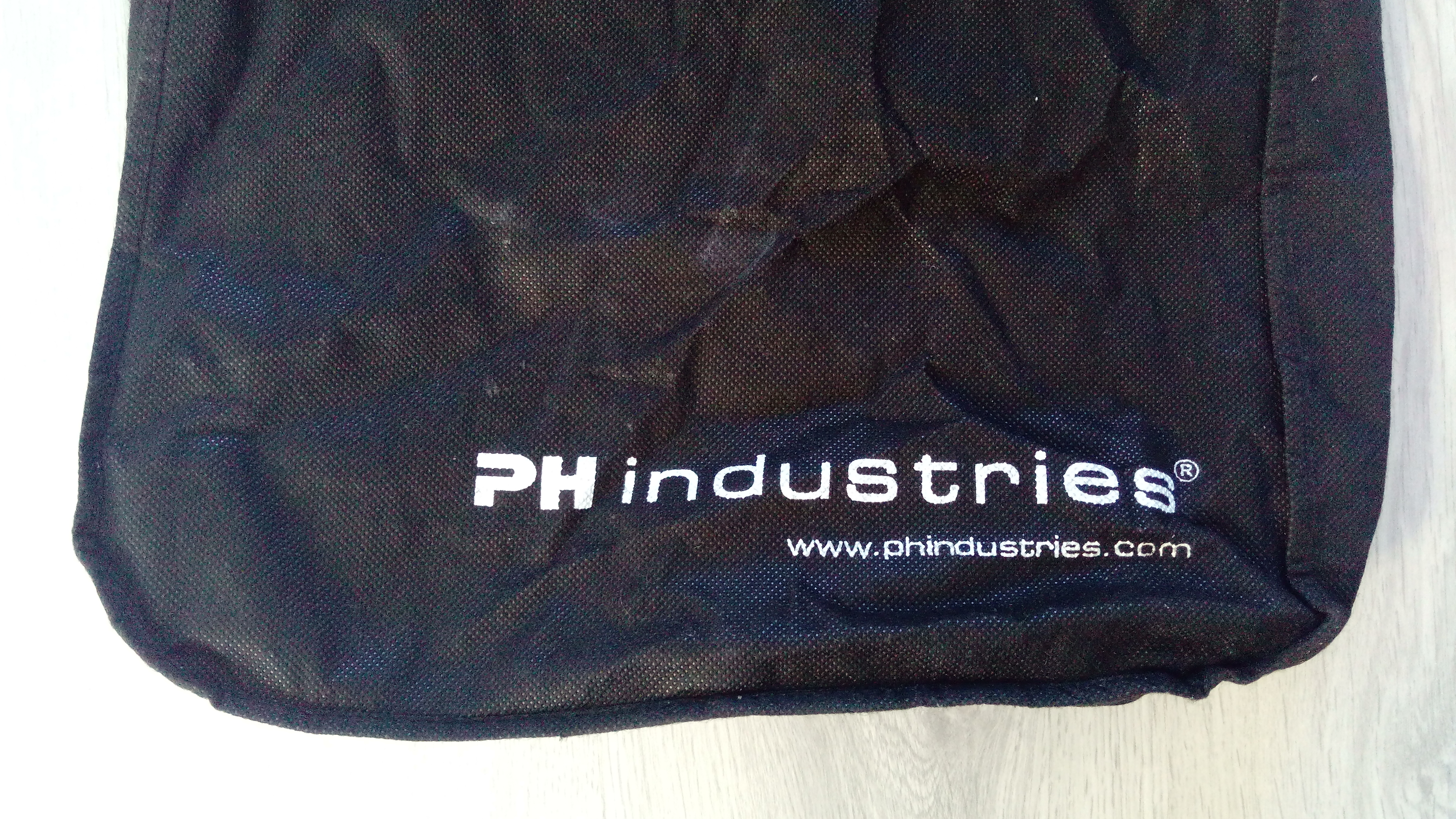 I, the copyright holder of this work, hereby publish it under the following license: English A shopping bag issued by the PH Industries.