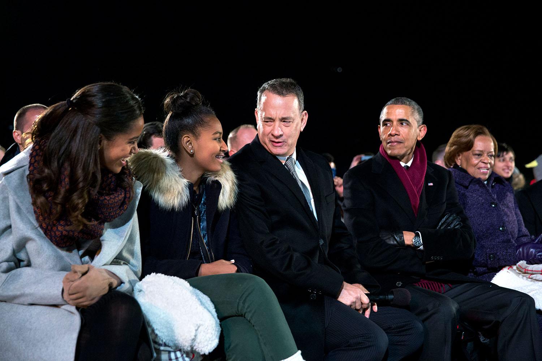 File President Barack Obama Seated With Daughters Malia And Sasha