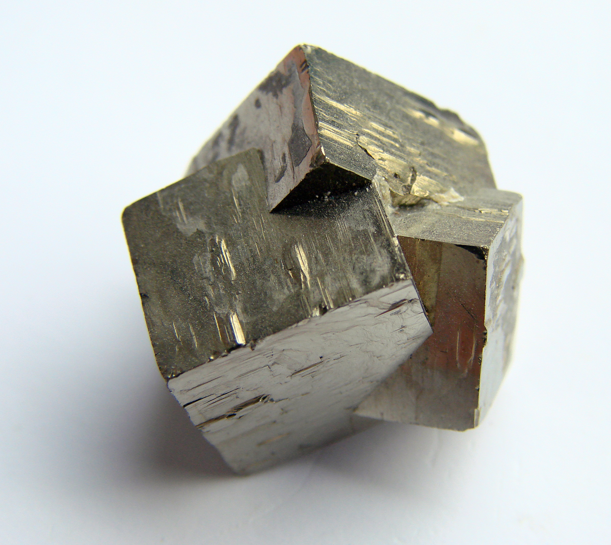 Twinned pyrite crystal group.