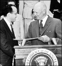 Photo of Dr. Jonas Salk receiving a Gold Medal from President Eisenhower