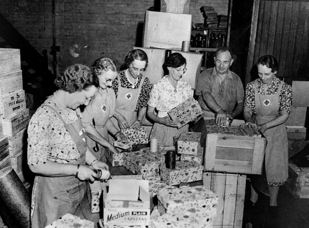 red cross workers packing christmas presents for the fighting forces during world war ii october 1942