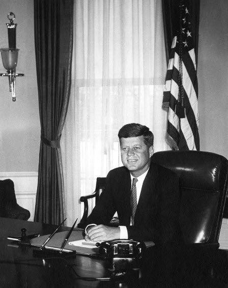 US Navy 110529-O-ZZ999-002 Portrait photo of President John F. Kennedy at his desk in the Oval Office, White House, Washington, D.C