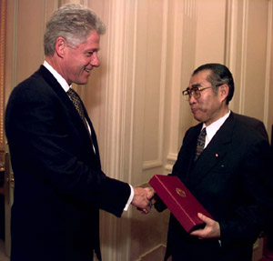 with Bill Clinton (in Chiyoda, Tokyo on November 20, 1998) Clinton and Obuchi.jpg