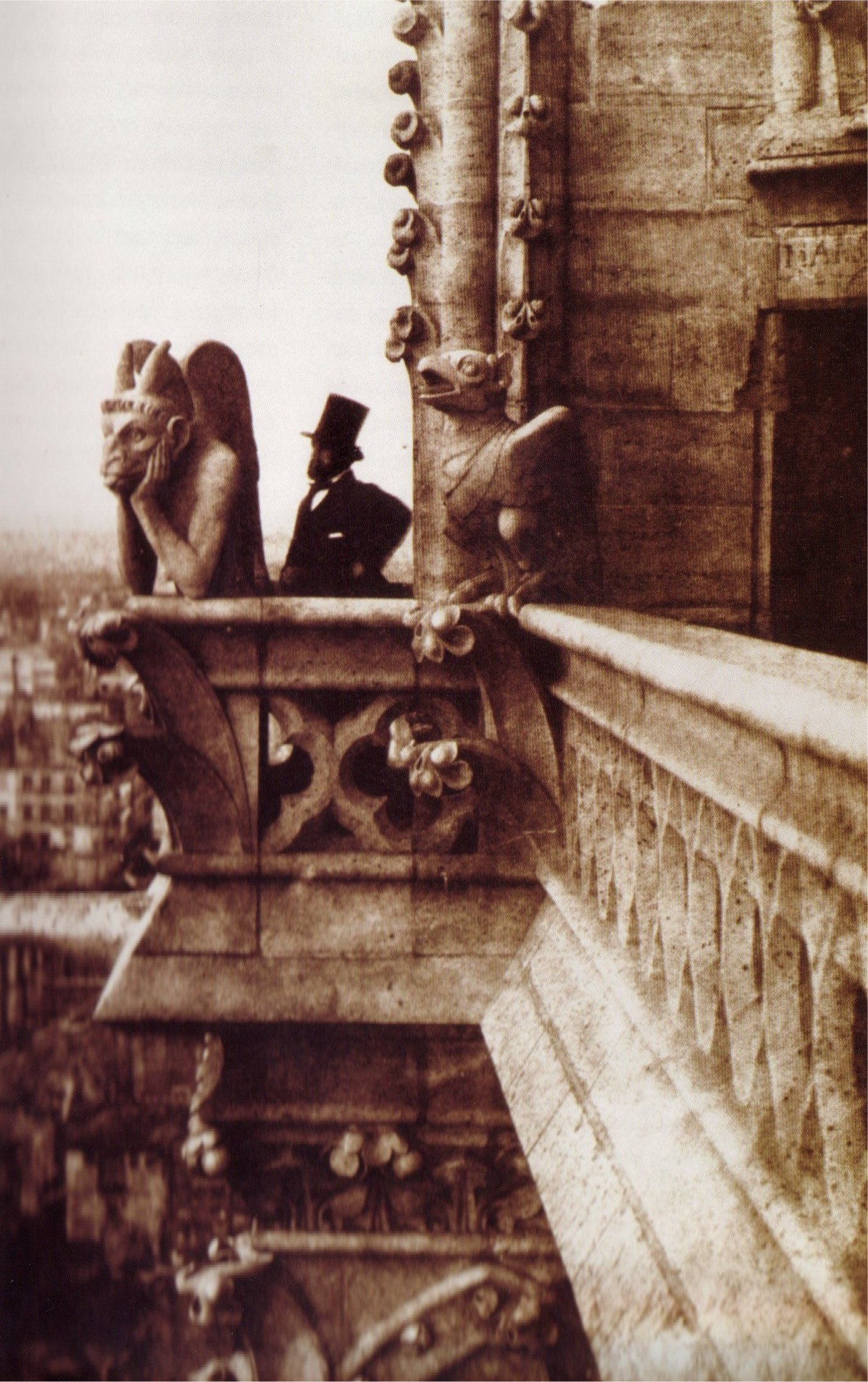 A picture taken by en:Charles Negre in en:1853. Of Henri Le Secq near the 'Stryge' chimera on en:Notre Dame de Paris.