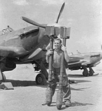 No 20 Sqn RAF sergeant with rockets Burma 1945