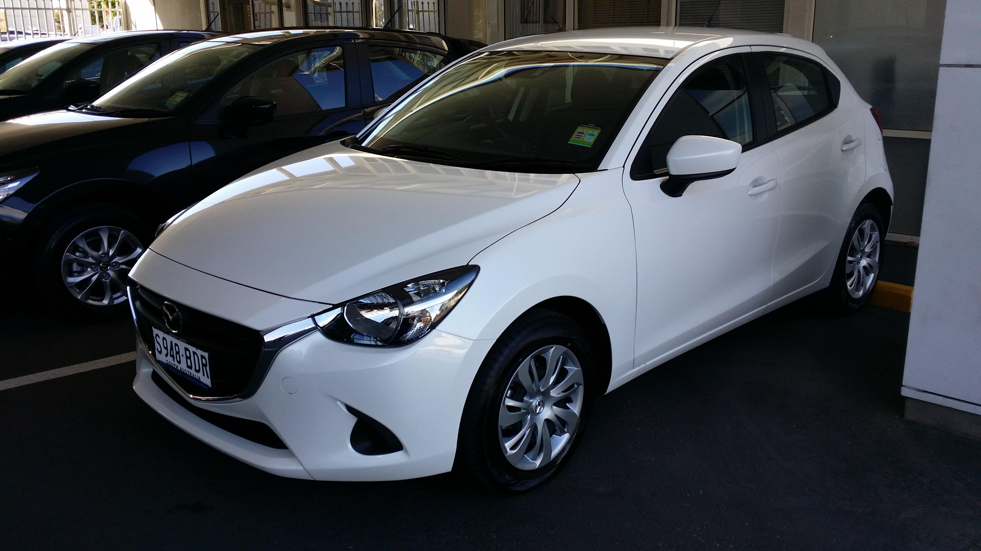 white Mazda2 image