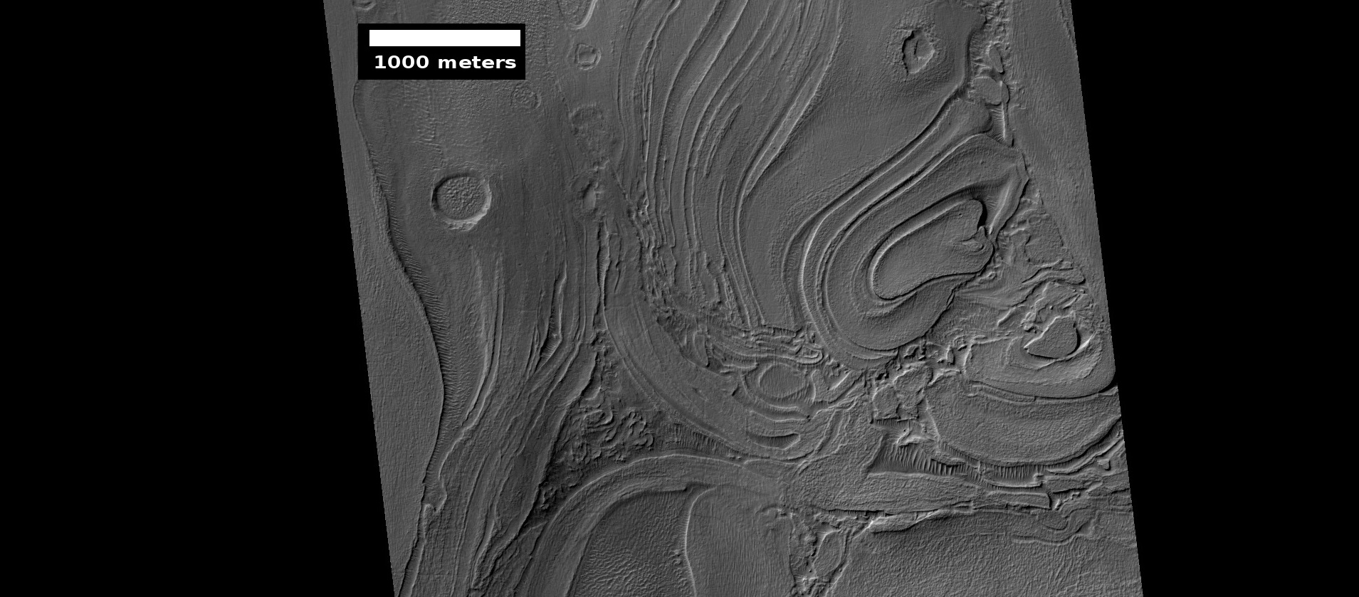 Close-up of banded terrain on the floor of the Hellas basin, as seen by HiRISE