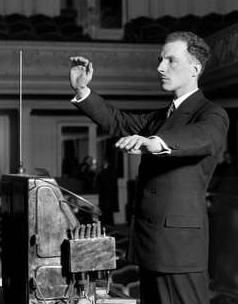 Leon Theremin demonstrating the theremin in 1927 Lev Termen playing - cropped.jpg