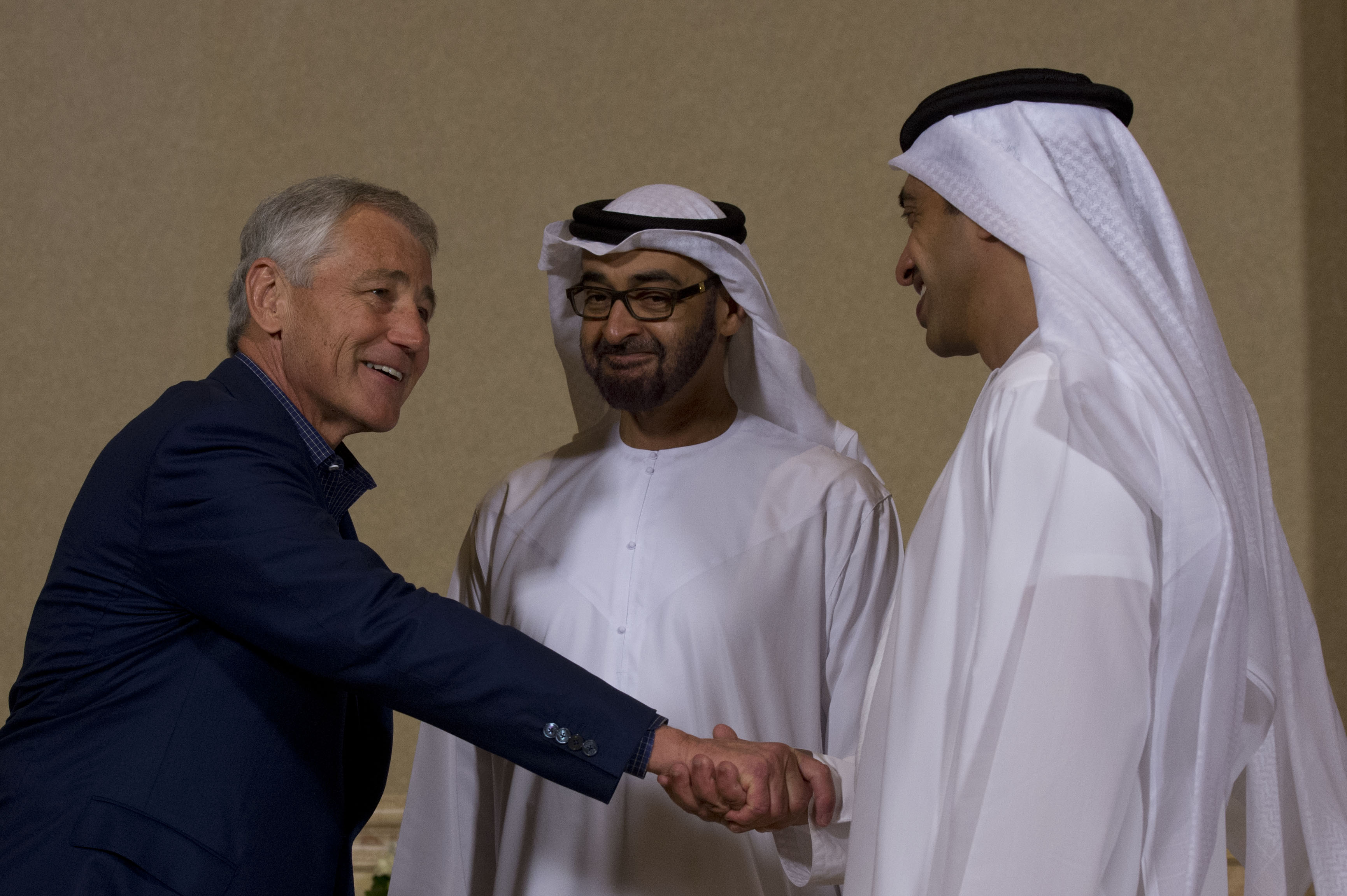 Fileus secretary of defense chuck hagel left exchanges exchanges greetings with gen mohammed bin zayed al nahyan center the crown prince of abu dhabi and the deputy supreme commander of the united arab m4hsunfo