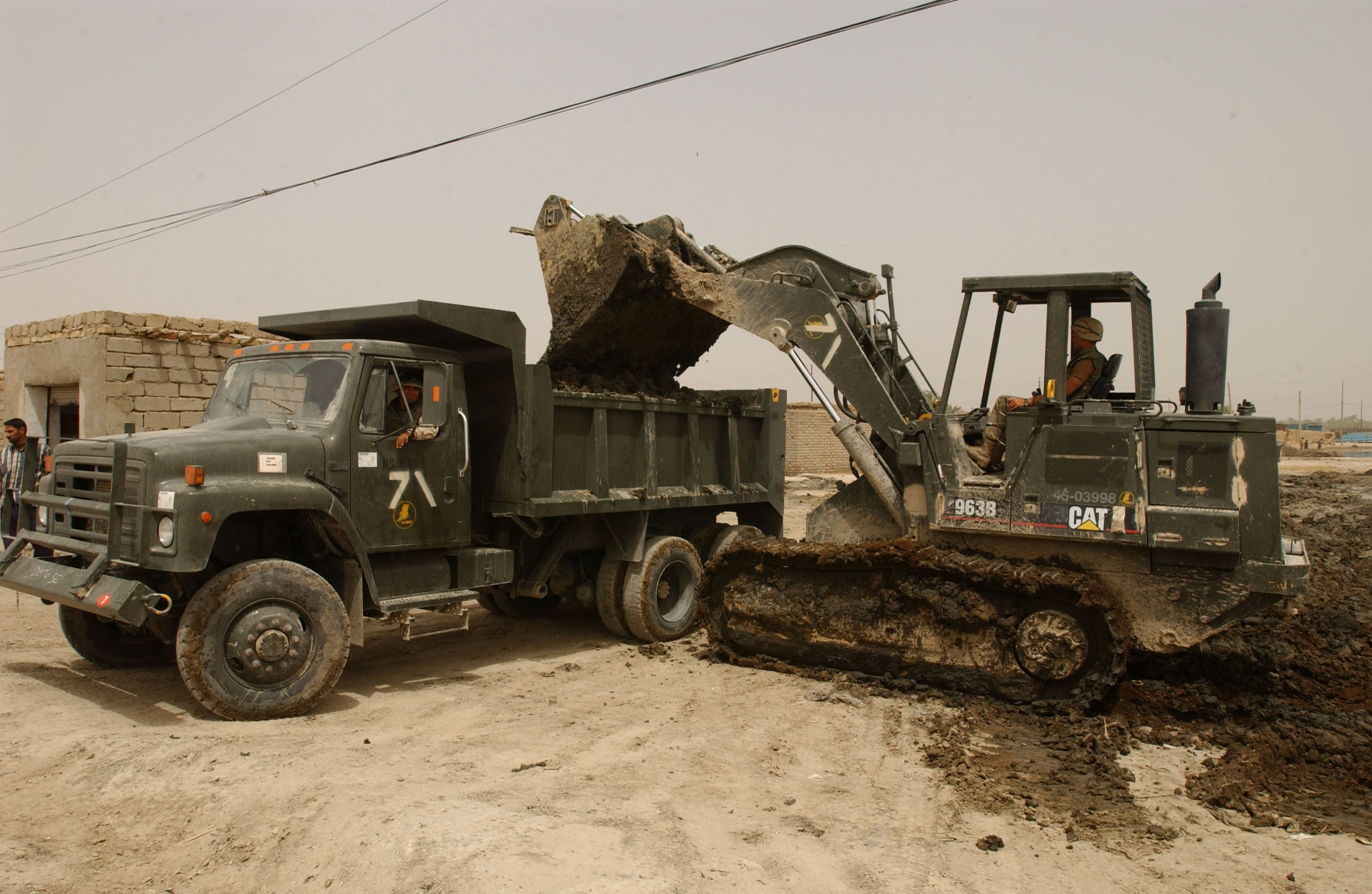file us navy 030502 n 6077t 016 seabees use a dump truck and front
