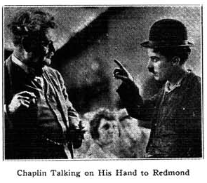 "caption=""Chaplin Talking on His Hand to Redmond"""