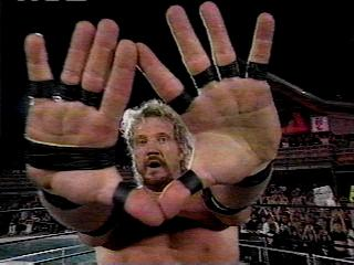"Page's infamous ""Diamond Cutter"" hand gesture"