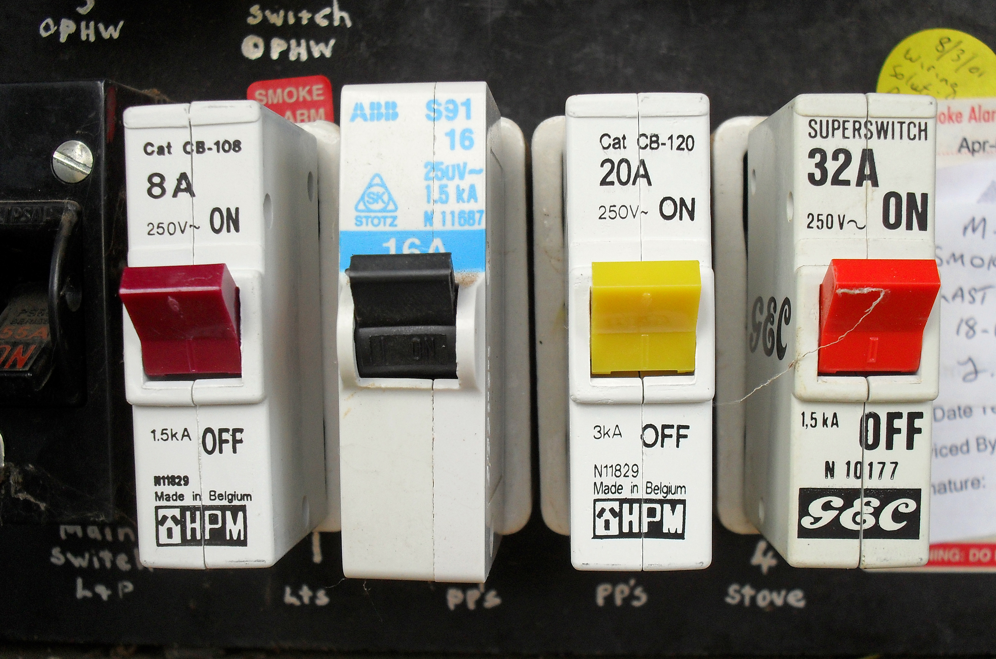 Four 1 pole circuit breakers fitted in a meter box.jpg