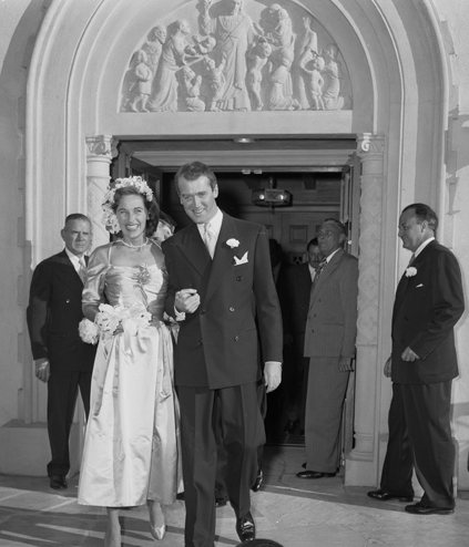 Stewart and Gloria H. McLean walking out of Brentwood Presbyterian Church after their wedding ceremony, 1949 J.StewartMarriage.jpg