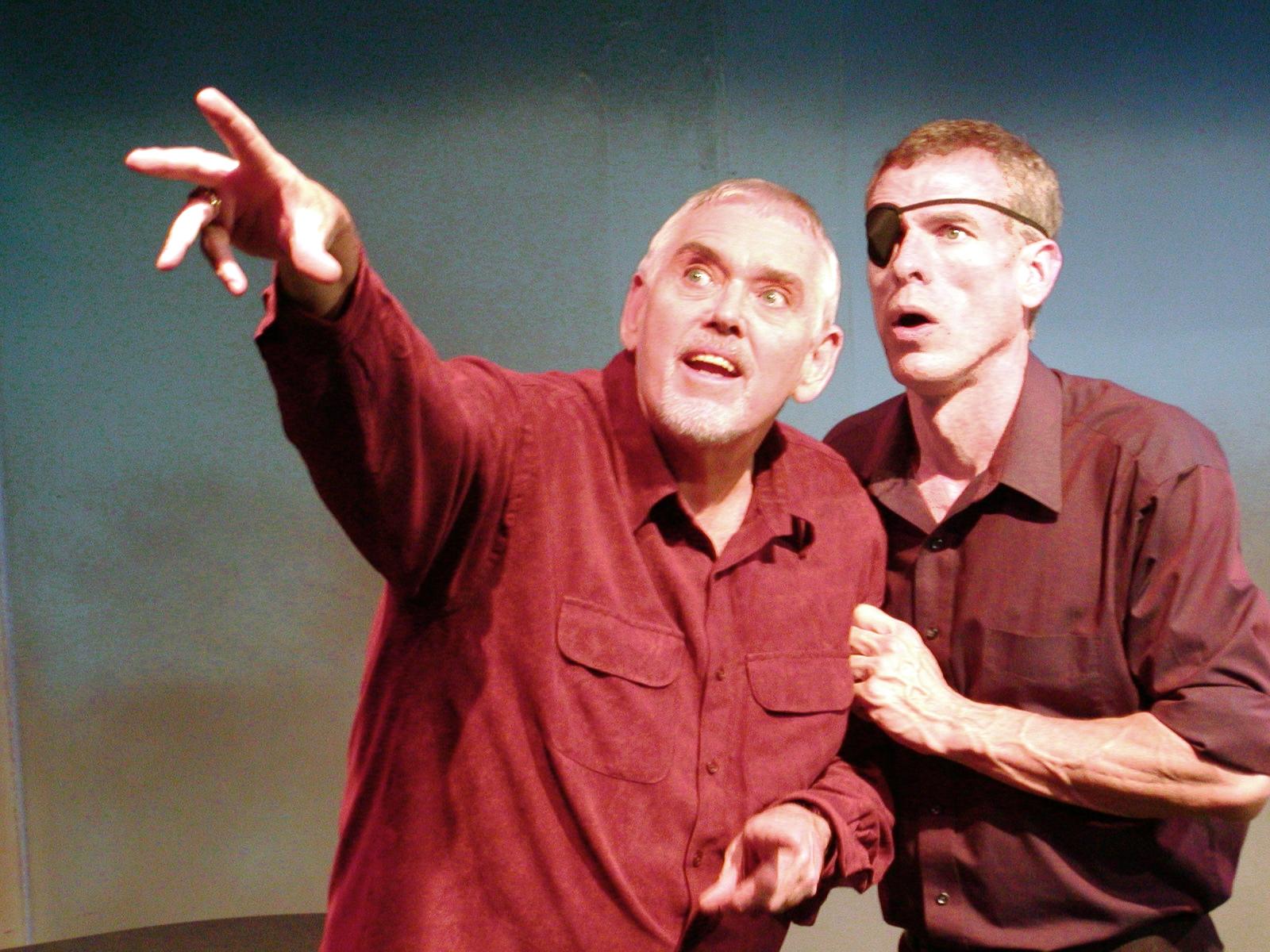 Actors Jim Brochu and Steve Schalchlin performing in The Big Voice: God or Merman play.