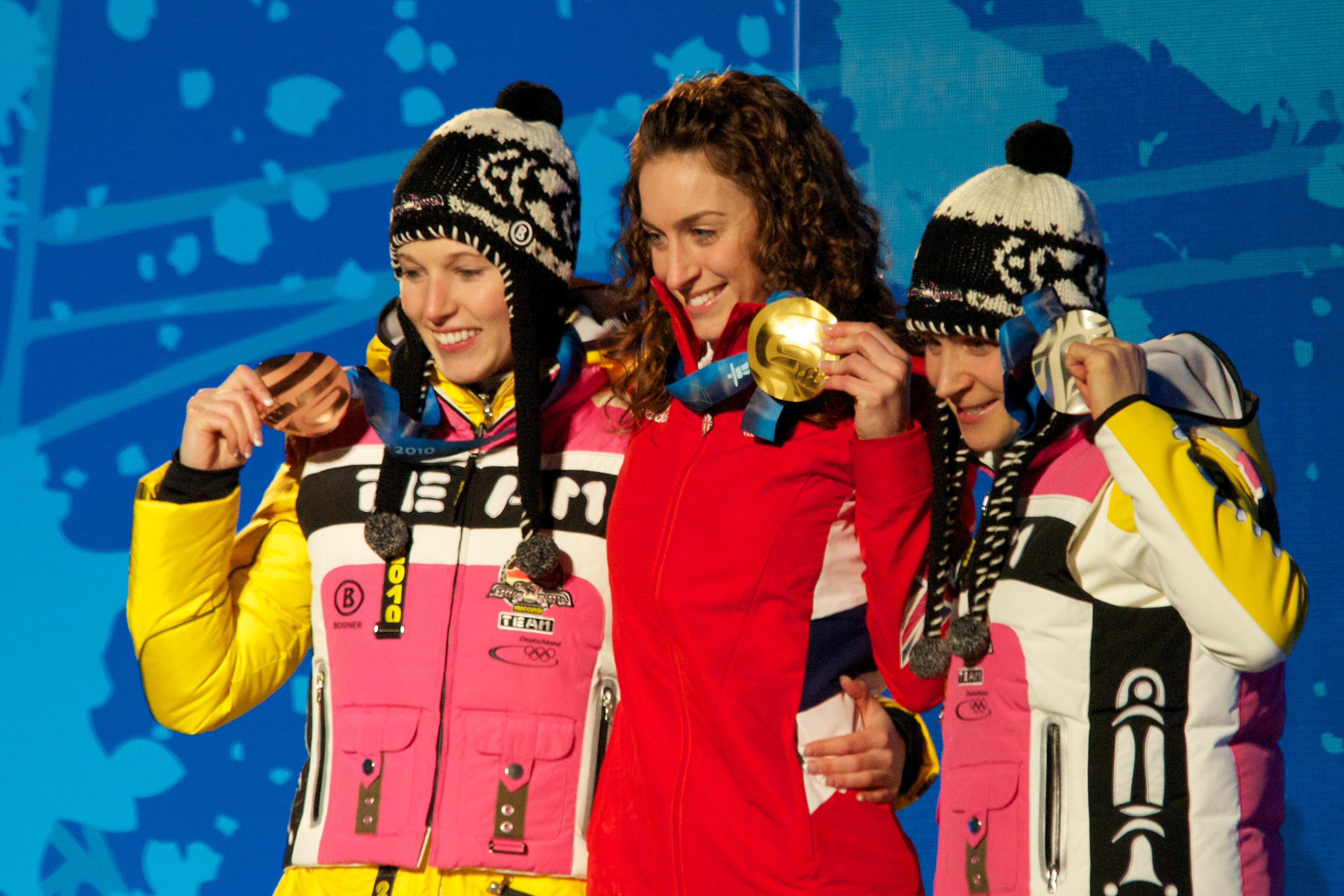 Szymkowiak (right) at the 2010 Winter Olympics women's skeleton medal ceremony