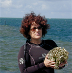 Photo of Mary Hagedorn working in the field with coral species