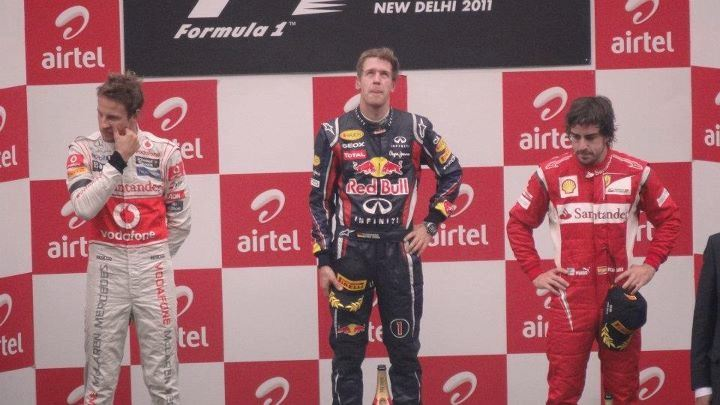 From left to right: Jenson Button, Sebastian Vettel and Fernando Alonso on the podium Podium winners of 2011 Indian Grand Prix.jpg