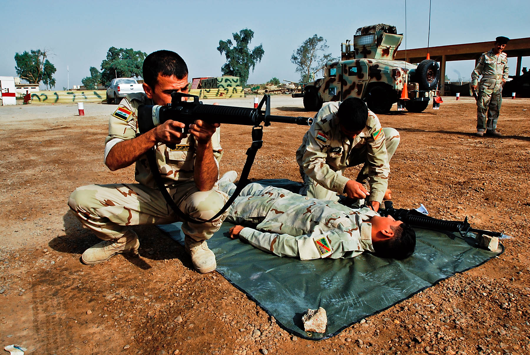 security during a training exercise as a wounded comrade receives