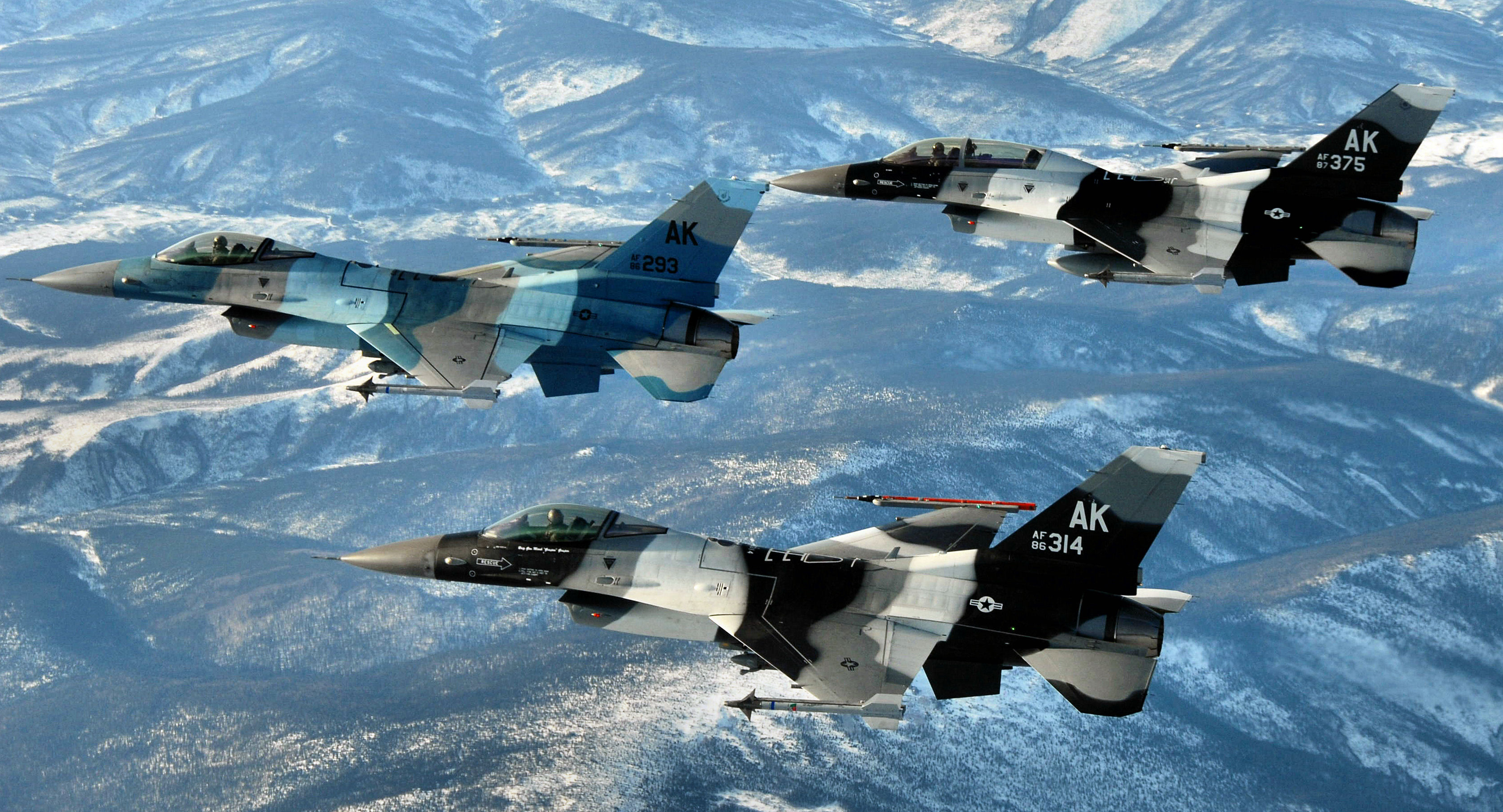 Three f 16s from the 18th aggressor squadron fling over the alaska
