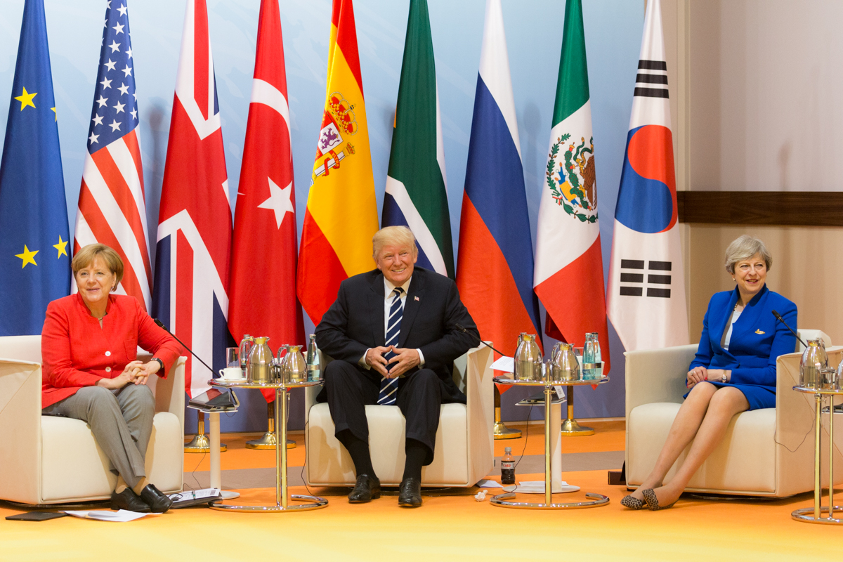 https://upload.wikimedia.org/wikipedia/commons/7/76/Angela_Merkel%2C_Donald_Trump_and_Theresa_May_at_the_G-20_Hamburg_summit%2C_July_7%2C_2017.jpg