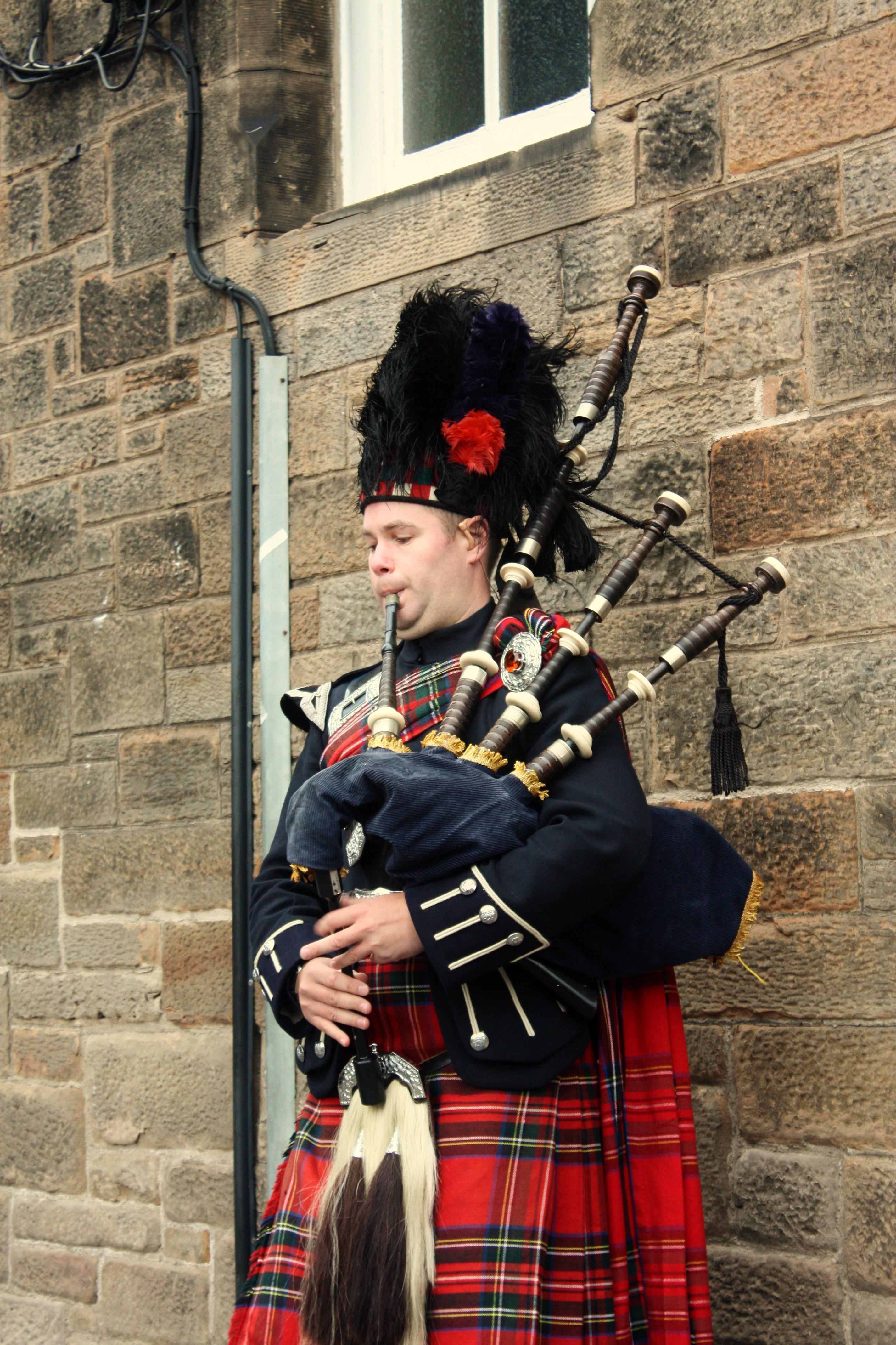 A piper busking in central Edinburgh.