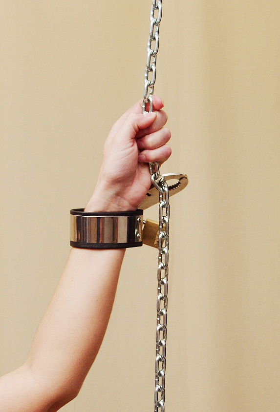 Padded locking leather suspension cuffs male stockroom