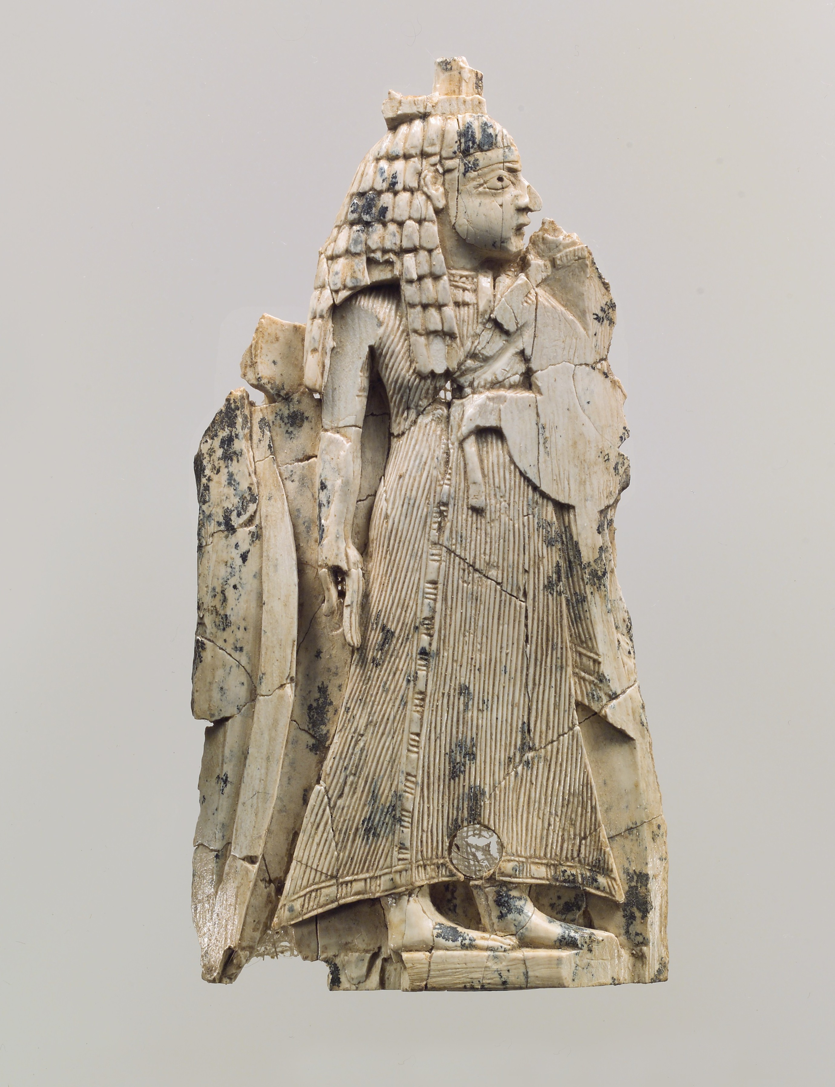 File furniture plaque carved in relief with a female figure met