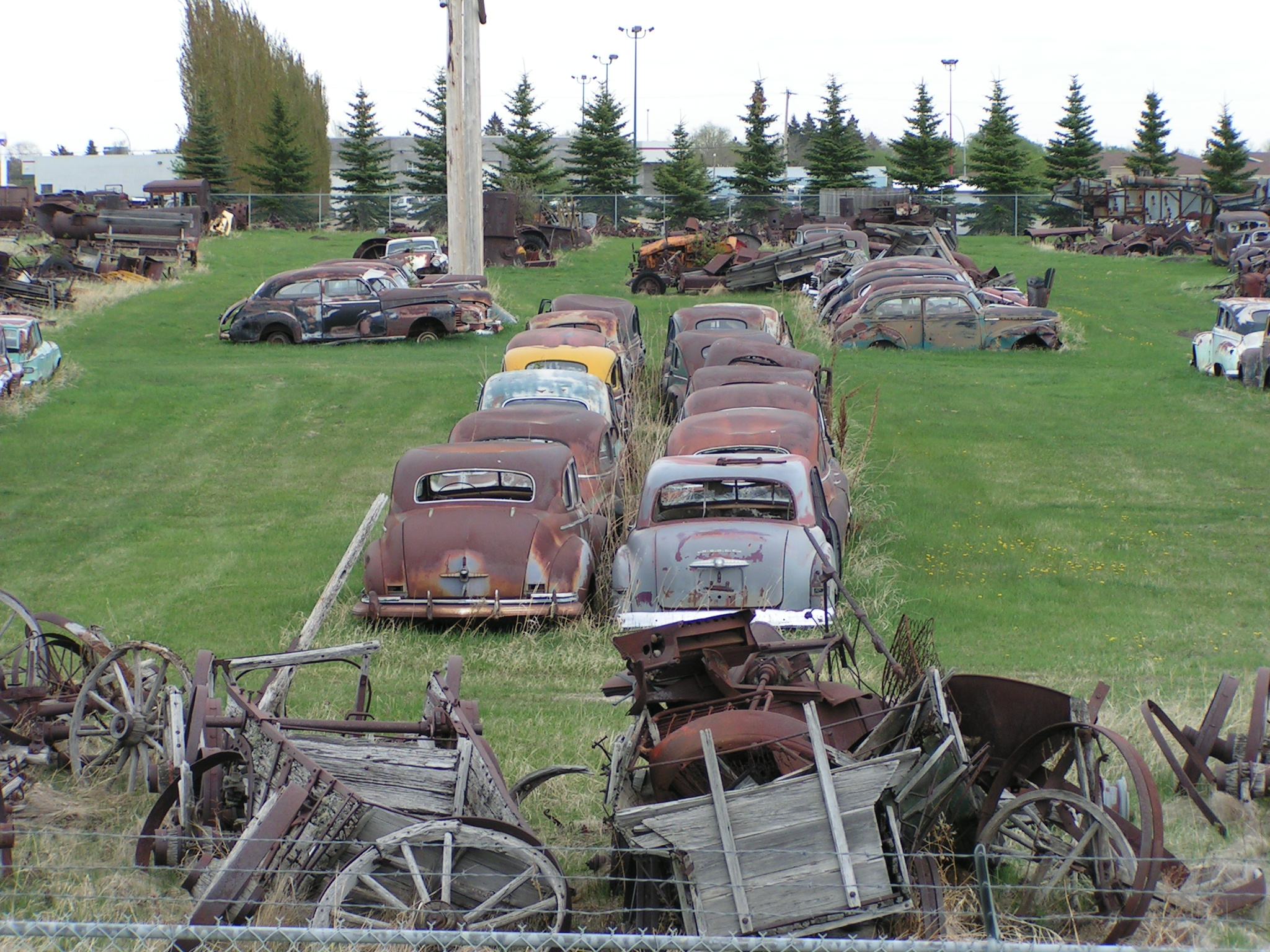 File:Old rusty cars and agricultural equipment (2553217947).jpg ...