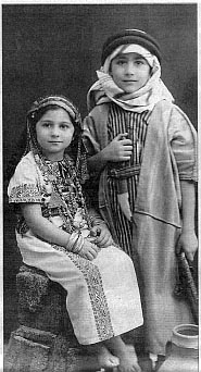 A photo of Edward Said and his sister as children, dressed in Arab-style clothing.