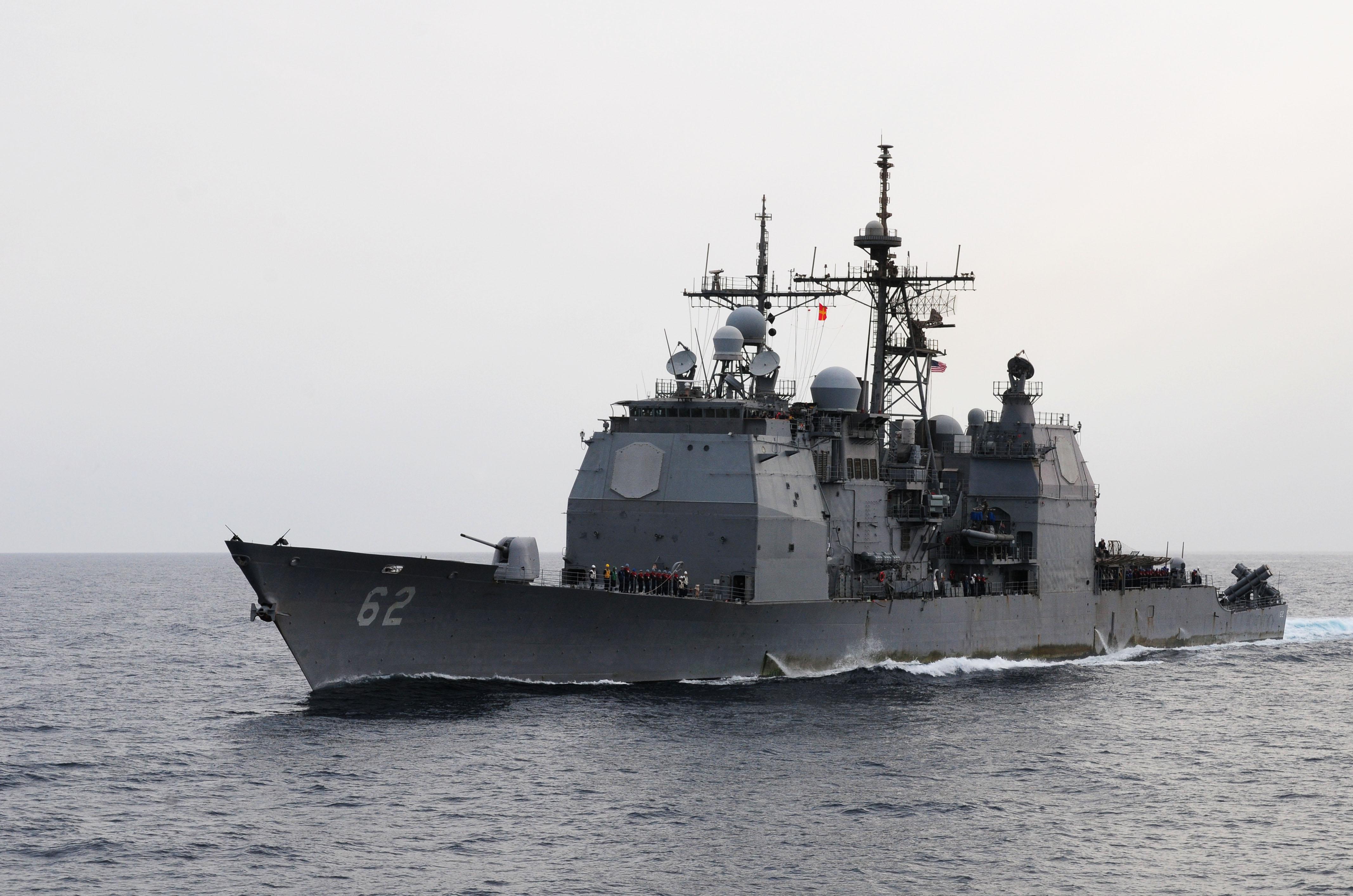US_Navy_110728-N-SB672-135_USS_Chancellorsville_%28CG_62%29_transits_alongside_USS_Ronald_Reagan_%28CVN_76%29_for_a_fueling_at_sea.jpg