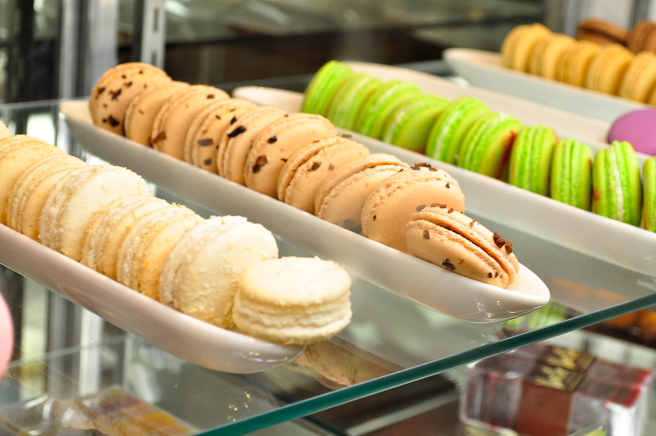 Displays of colorful macaroon cookies