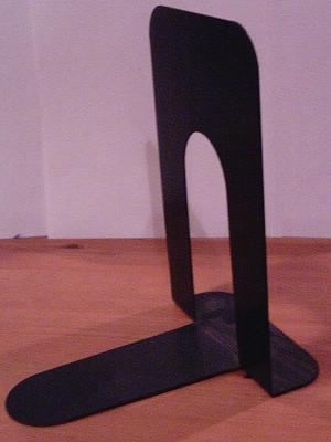 A black metal bookend.