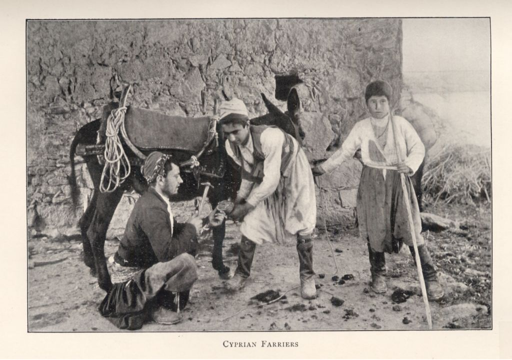 English: Two men shoeing a donkey. Black-and-w...