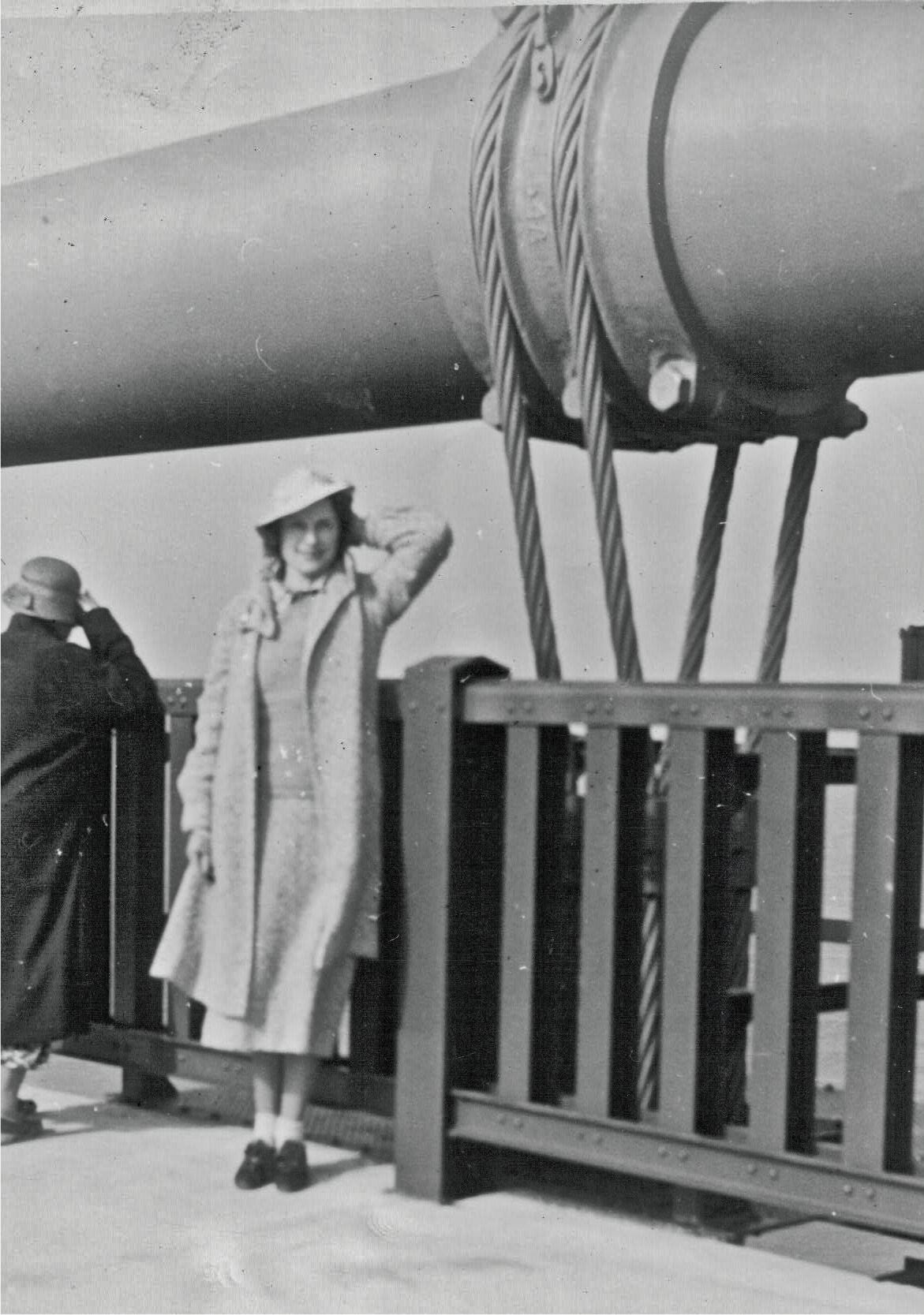 Image result for A pedestrian poses at the old railing on opening day, 1937.