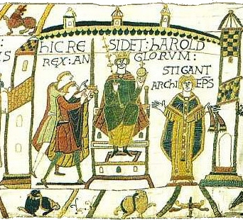 "HIC RESIDET HAROLD REX ANGLORUM. STIGANT ARCHIEP(I)S(COPUS). ""Here sits Harold King of the English. Archbishop Stigand"". Scene immediately after crowning of Harold by (according to the Norman tradition) Archbishop of Canterbury Stigand (d. 1072). Detail from the Bayeux Tapestry. KingHarold Coronation BayeuxTapestry.PNG"