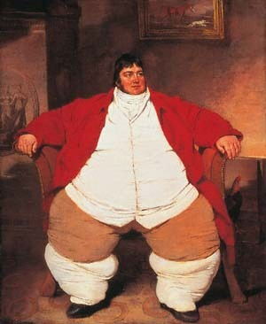 Smartly dressed fat man with dark hair and a red waistcoat, sitting on a chair