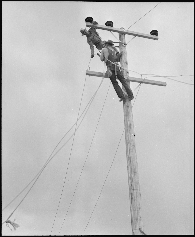 File:Poston, Arizona. Light poles and wiring for electric lighting ...