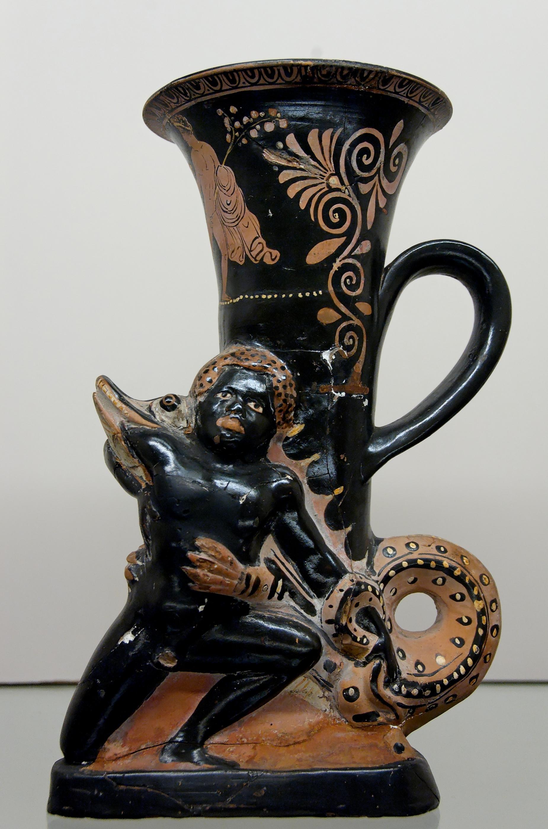 Rhyton a figure rosse, etiope divorato da coccodrillo.