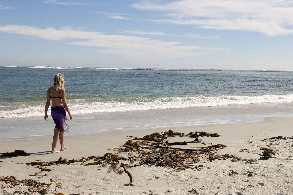 File:Woman walking on beach, Northern Cape (6253261452 ...