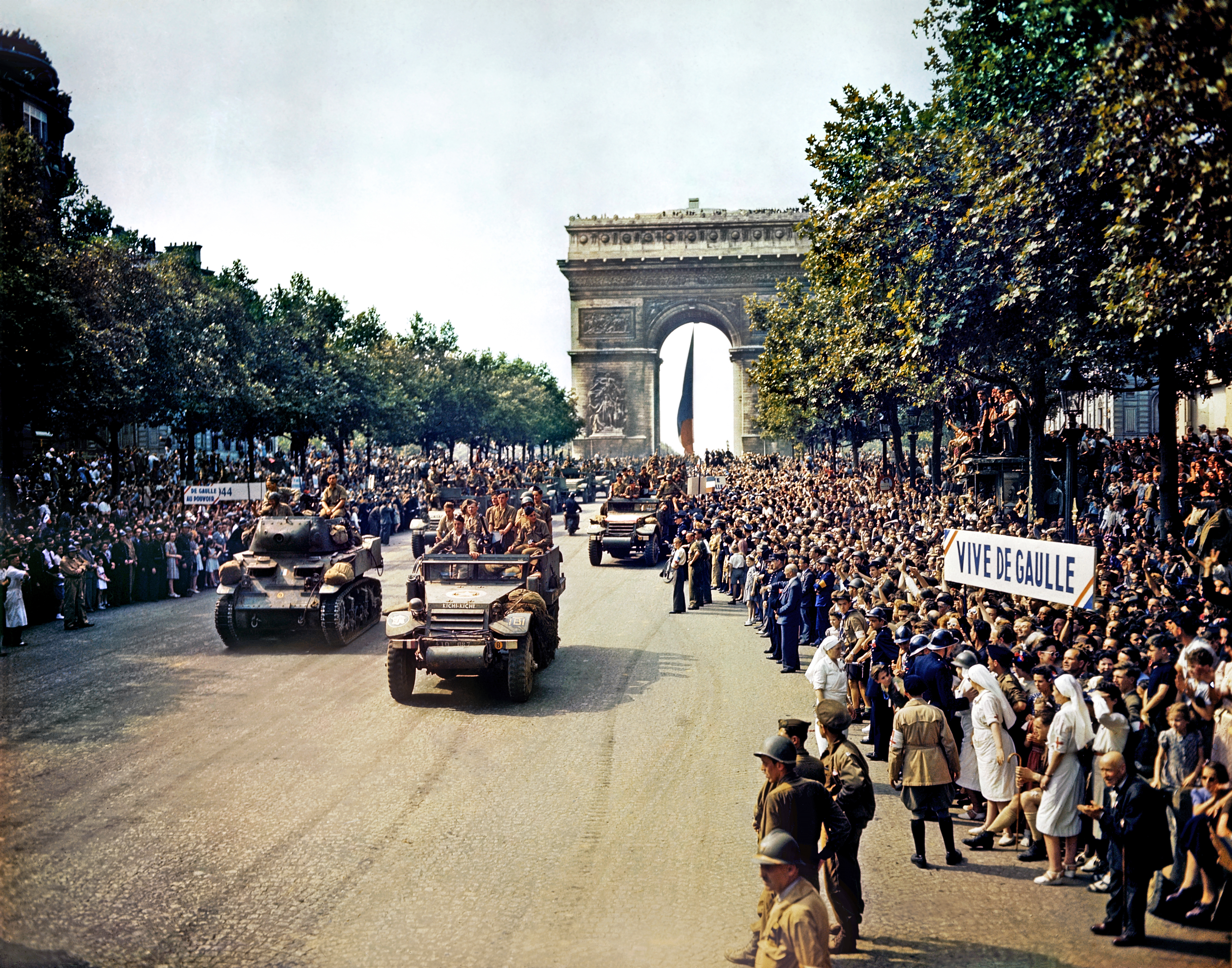 Leclerc's 2nd Armored Division parading down the Champs Elys es on 26 August 1944, the day after the Liberation of Paris.