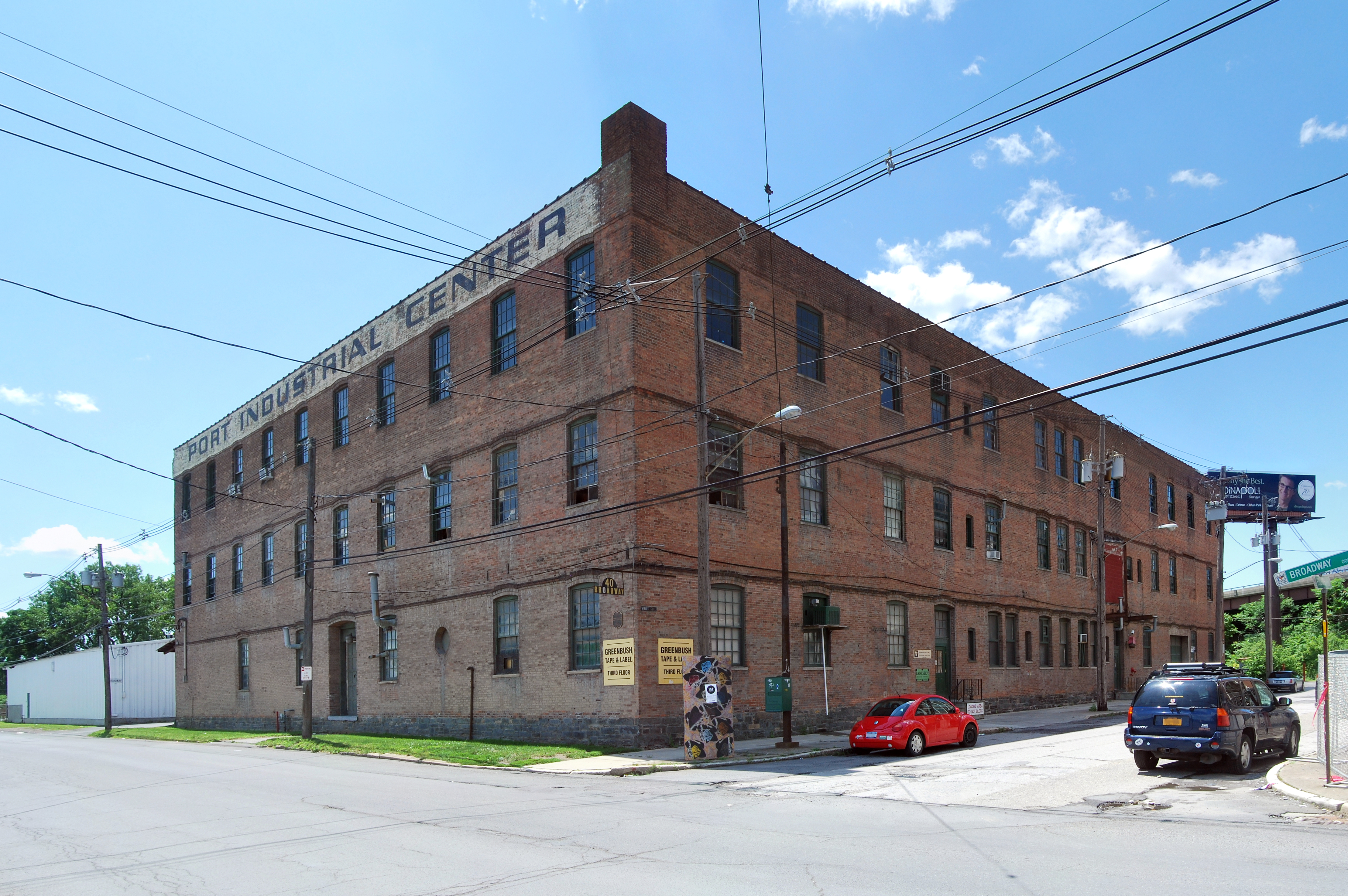 A Three Story Brick Building Seen From Its Right So That Two Sides Are