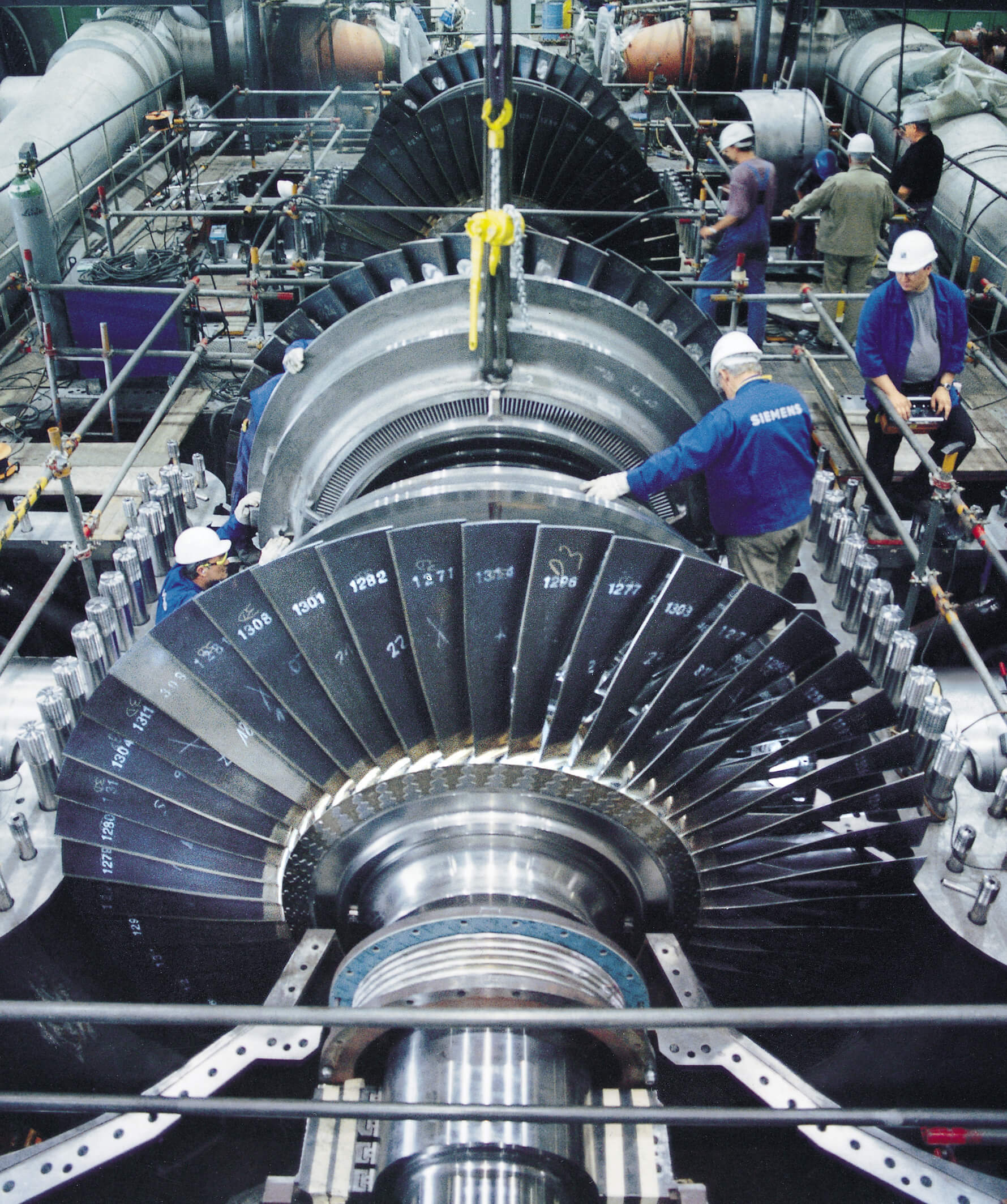 Design of a turbine requires collaboration of engineers from many fields, as the system is subject to mechanical, electro-magnetic and chemical processes. The blades, rotor and stator as well as the steam cycle all need to be carefully designed and optimized.