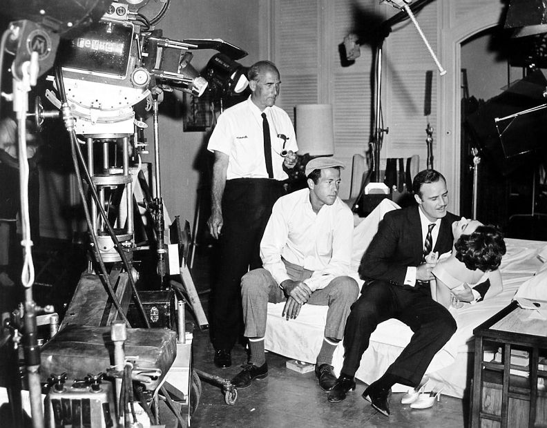 On the set of ''The Ugly American'' (1963), from left: cinematographer Clifford Stine, George Englund, [[Marlon Brando