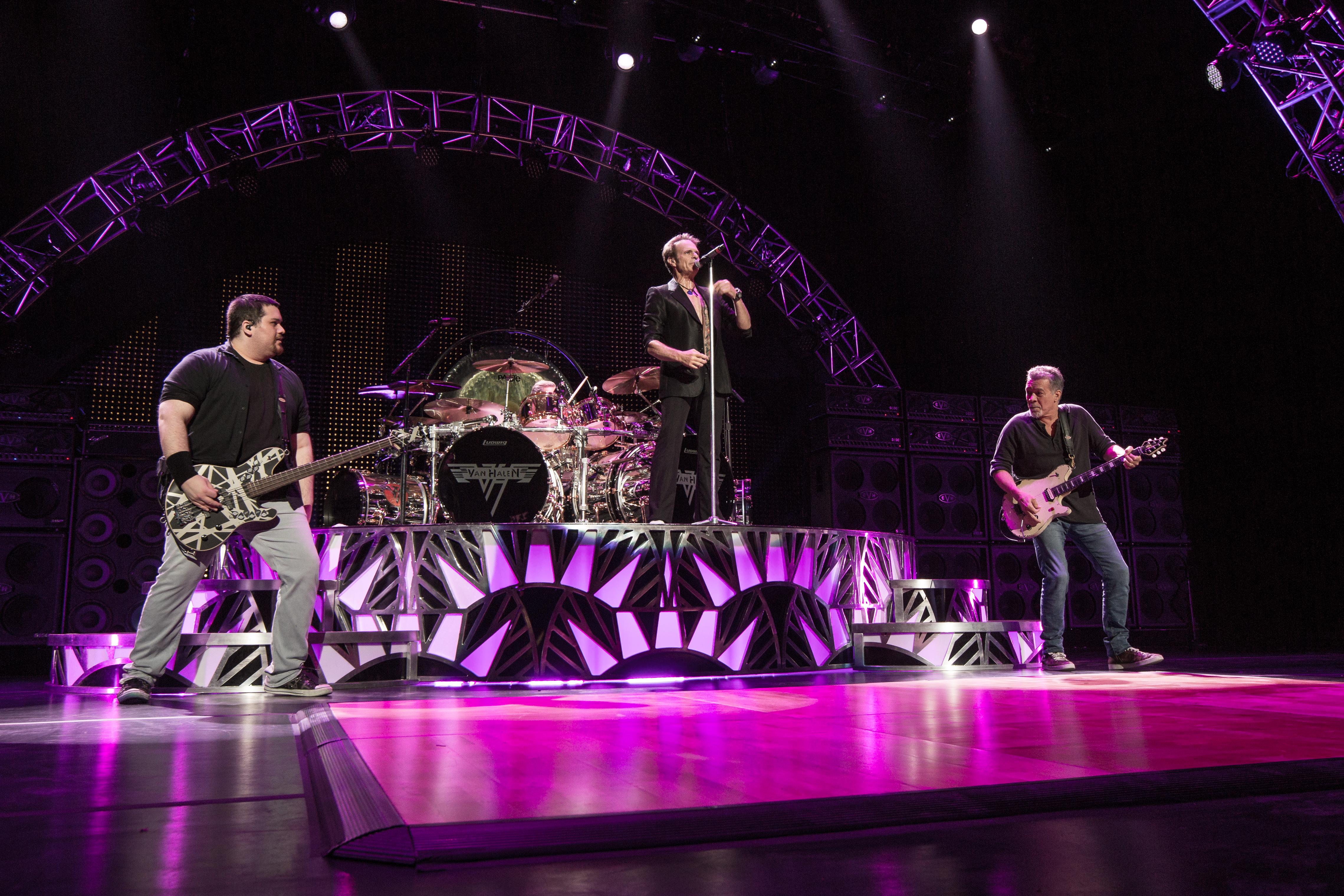 Van Halen performing in 2015. From left to right: [[Wolfgang Van Halen]], [[Alex Van Halen]], [[David Lee Roth]], and [[Eddie Van Halen]].