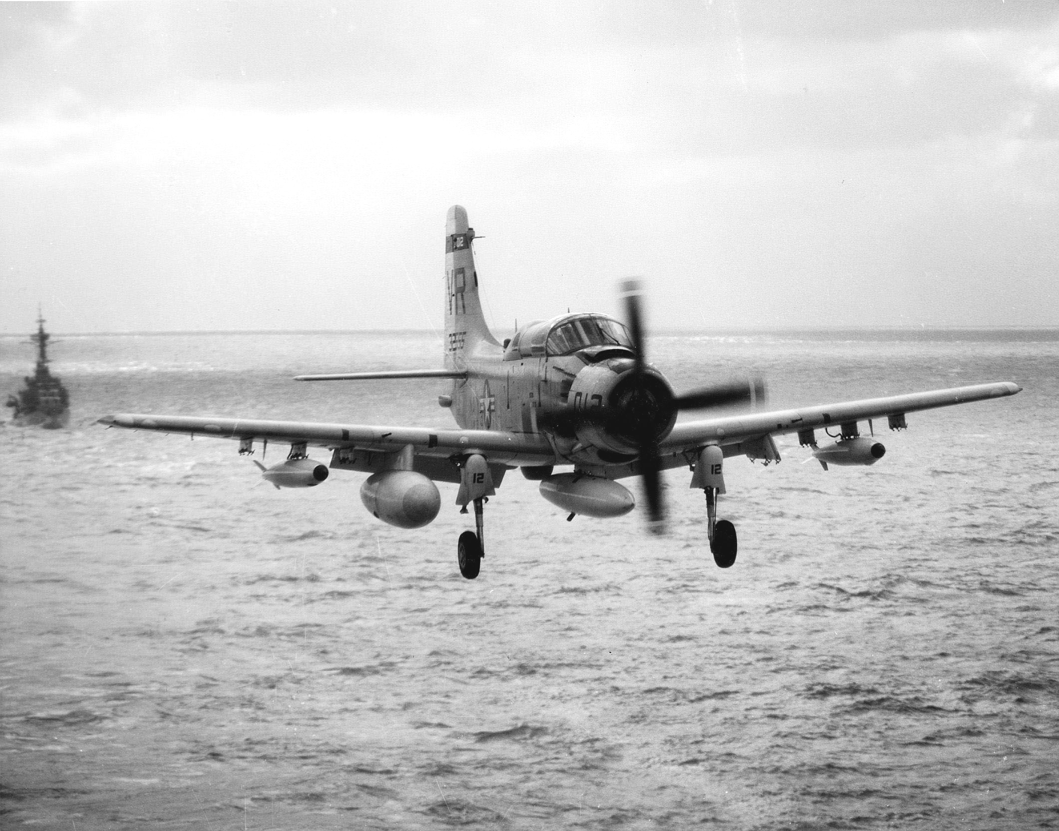 File:EA-1F Skyraider of VAW-13 Det.63 of approaches USS