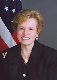official Department of State photo of Ellen Sauerbrey, seated in front of a U.S. flag