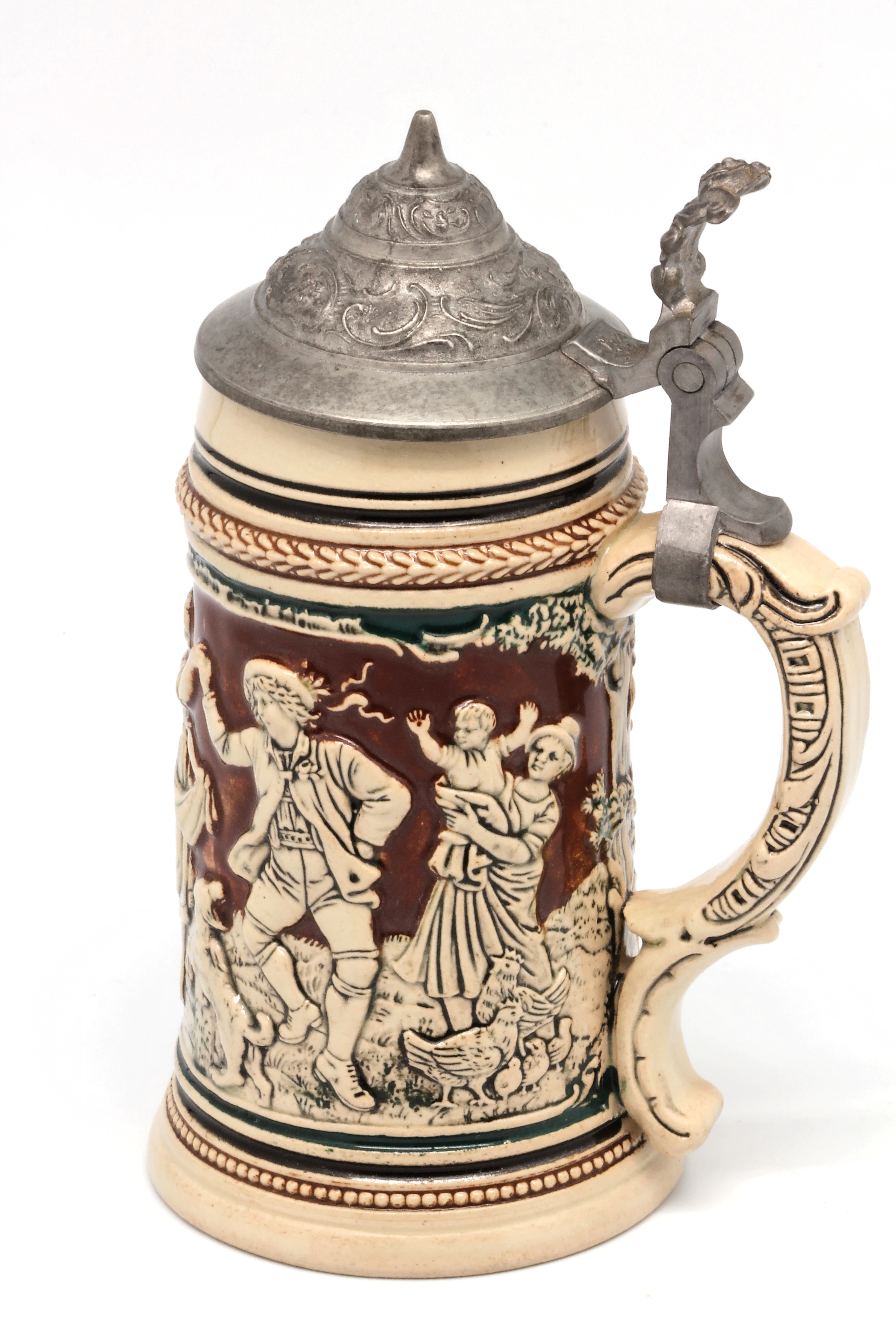 file faience beer stein with ball scene on brown